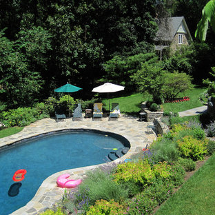 Elegant stone pool photo in Philadelphia