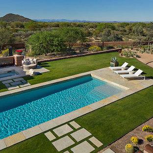Imagen de piscinas y jacuzzis alargados, de estilo americano, de tamaño medio, rectangulares, en patio trasero