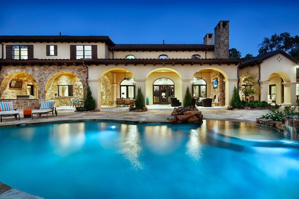 Mediterranean Pool by JAUREGUI Architecture Interiors Construction