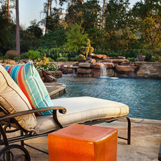 Traditional Pool by JAUREGUI Architecture Interiors Construction