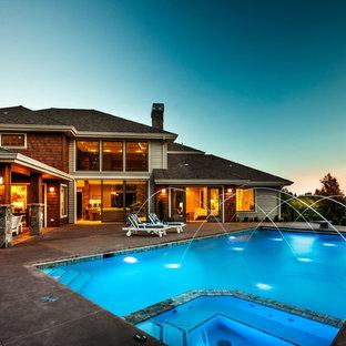 Modelo de piscinas y jacuzzis alargados, clásicos, extra grandes, rectangulares, en patio trasero, con losas de hormigón