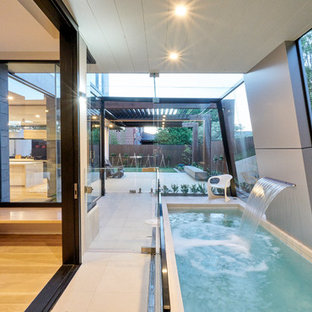 Inspiration for a contemporary indoor rectangular lap pool in Melbourne with a water feature and tile.