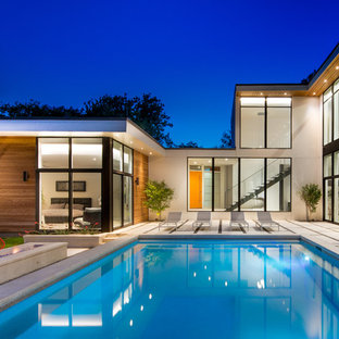 Large trendy backyard rectangular and concrete pool photo in Dallas