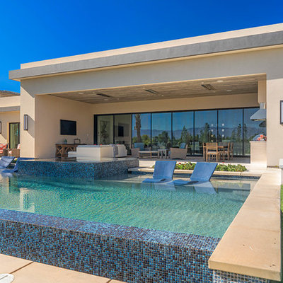 Hot tub - contemporary backyard rectangular aboveground hot tub idea in Orange County