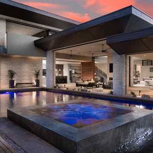 Hot tub - large contemporary backyard tile and l-shaped hot tub idea in Sacramento