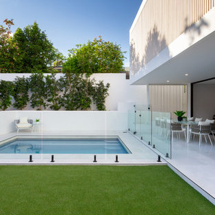 Design ideas for a small contemporary rectangular pool in Brisbane with tile.