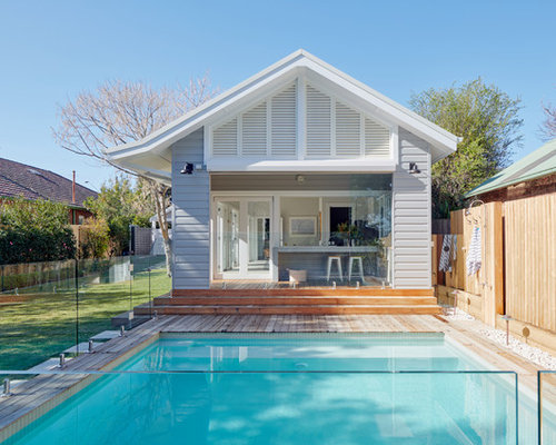 Transitional Backyard Rectangular Pool In Sydney With A Pool House And  Decking.