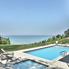 Beach Style Pool by Cottage Home, Inc.