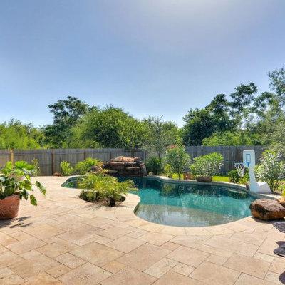 Pool fountain - mid-sized rustic backyard stone and custom-shaped natural pool fountain idea in Austin