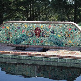 Tuscan brick pool photo in Los Angeles