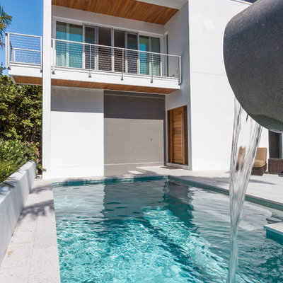 Pool fountain - mid-sized contemporary backyard concrete paver and rectangular natural pool fountain idea in Tampa