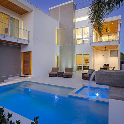 Inspiration for a mid-sized contemporary backyard concrete paver and rectangular natural pool fountain remodel in Tampa
