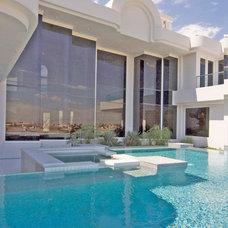 Modern Pool by Richard Luke Architects P.C.