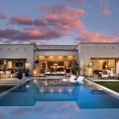 Inspiration for a contemporary backyard tile and rectangular lap pool remodel in Phoenix