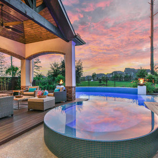 Design ideas for a large transitional backyard rectangular natural pool in Houston with a hot tub and concrete slab.