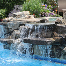 Traditional Pool by Landscape Techniques Inc.