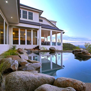 Inspiration for a mid-sized rustic courtyard stone and custom-shaped natural pool fountain remodel in Brisbane