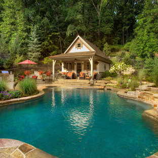 Inspiration for a mid-sized arts and crafts side yard custom-shaped natural pool in Detroit with a pool house and brick pavers.