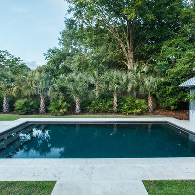 Inspiration for a tropical backyard concrete paver and rectangular lap pool house remodel in Charleston