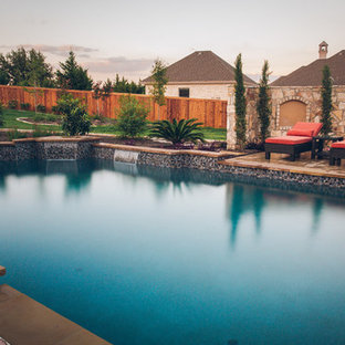 Example of a large classic backyard custom-shaped and stone lap pool house design in Austin