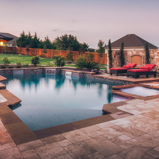 Pool house - large traditional backyard stone and custom-shaped lap pool house idea in Austin