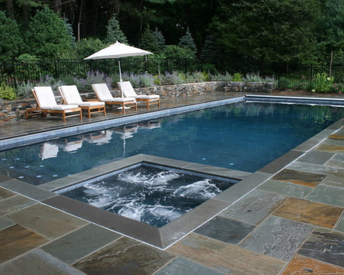 elegant rectangular pool photo in new york with natural stone pavers