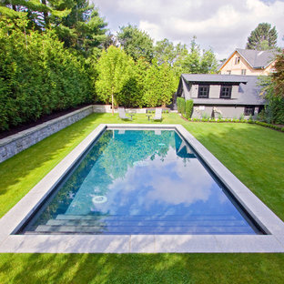 Elegant backyard rectangular pool photo in Vancouver
