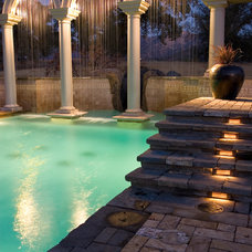 Traditional Pool by Artisan Home Resorts