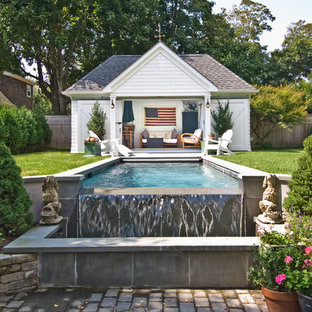 Example of a classic pool house design in New York