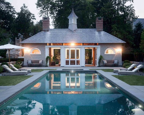 Example Of A Classic Rectangular Pool House Design In New York