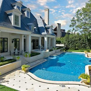 Pool fountain - traditional custom-shaped pool fountain idea in Dallas