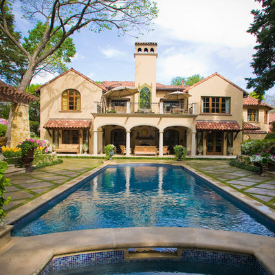 Inspiration for a large timeless backyard rectangular pool remodel in Dallas