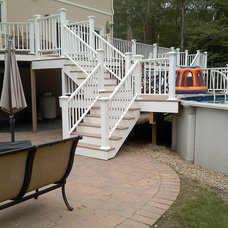 Traditional Pool by KNM Construction