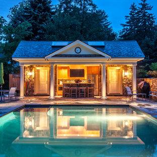 Ejemplo de casa de la piscina y piscina alargada, clásica, rectangular, con suelo de hormigón estampado