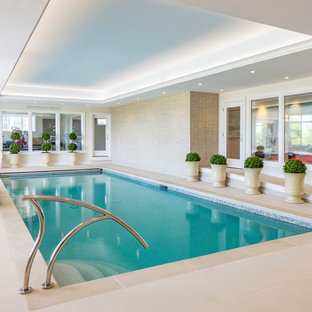 Inspiration for a traditional rectangular pool in Other with tile.