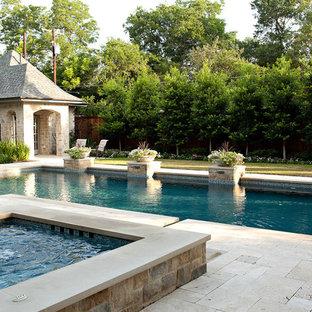 Large elegant backyard rectangular pool photo in Dallas