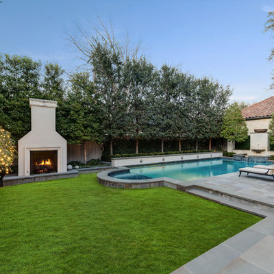 Transitional backyard concrete paver and rectangular lap pool fountain photo in Dallas