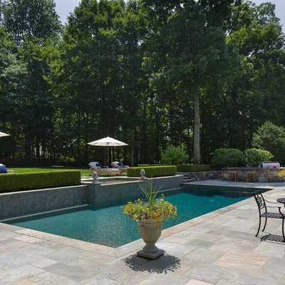 Inspiration for a mid-sized transitional backyard stone and rectangular lap hot tub remodel in New York