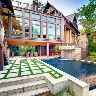Inspiration for a contemporary concrete paver infinity pool remodel in Charleston