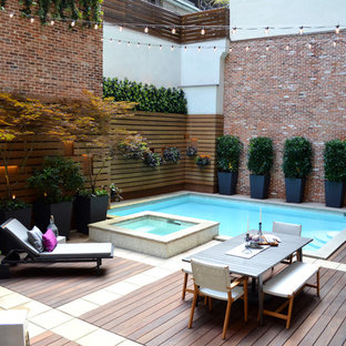 Hot tub - small contemporary courtyard rectangular hot tub idea in New York with decking
