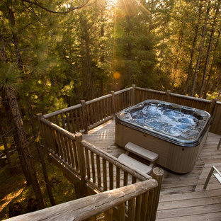 Photo of a small country backyard rectangular aboveground pool in Other with a hot tub and decking.