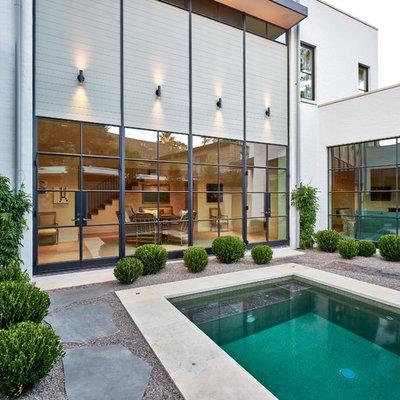 Small trendy backyard rectangular and gravel lap hot tub photo in Houston