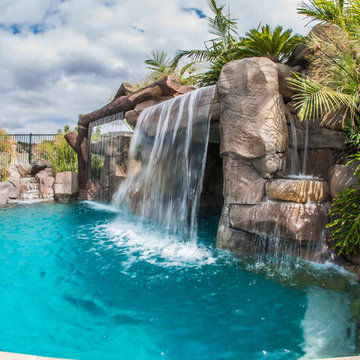 Tropical Beach Entry Pool & Spa with a Rock Slide & Grotto