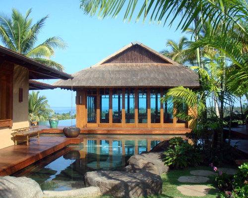 Backyard Pool House Designs turn your pool house into a secondary living zone and guest space design rick Inspiration For A Tropical Backyard Custom Shaped Natural Pool House Remodel In Hawaii With Decking