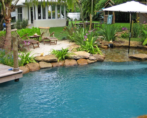 Example Of An Island Style Backyard Custom Shaped Pool Design In Miami