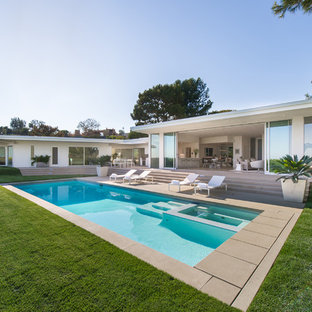 Pool - large 1960s backyard concrete and rectangular pool idea in Los Angeles
