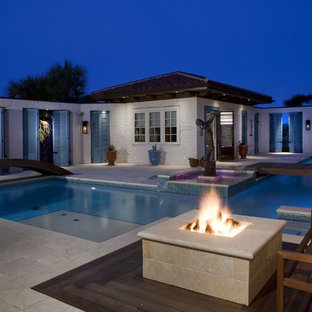 Example of an eclectic custom-shaped pool design in Other