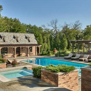 Elegant backyard rectangular hot tub photo in Chicago