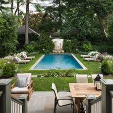 Traditional Pool by Eberlein Design Consultants Ltd.