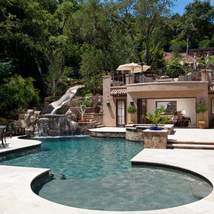 Example of a tuscan backyard pool house design in San Francisco